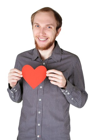 young man with beard in grey shirt holding red paper heart and smiling, half body, isolated Stock Photo - 7825523