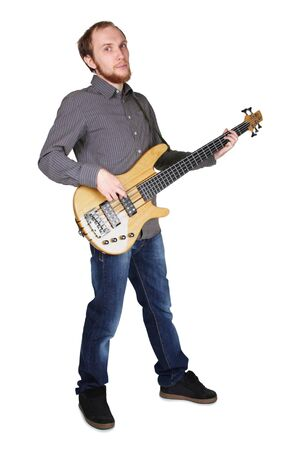 young man with beard in grey shirt and jeans playing bass guitar, full body, isolated photo