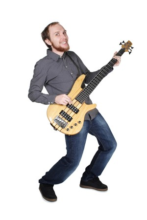 young man with beard in grey shirt and jeans playing bass guitar, bending and smiling, full body, isolated photo