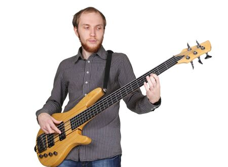 young man with beard in grey shirt playing bass guitar, half body, horizontal, isolated photo