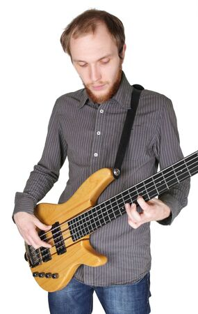 young man with beard in grey shirt playing bass guitar, half body, vertical, isolated photo