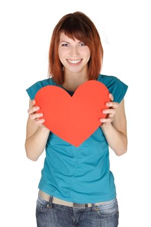 young redhead girl smiling and holding red paper heart, looking at camera, half body, isolated photo
