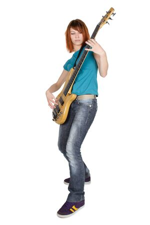 young beauty redhead girl playing bass guitar and smiling, full body, isolated photo