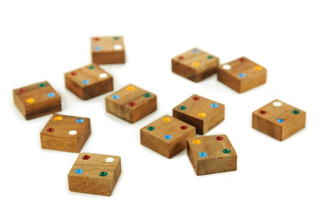 wooden square figures with color dots isolated photo