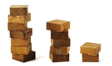 wooden square figures in pyramid isolated photo