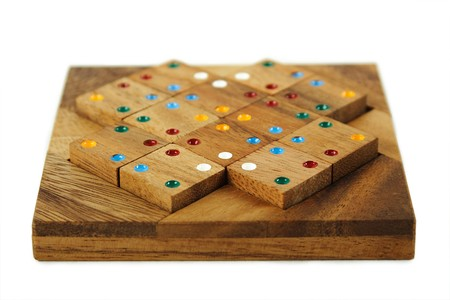 wooden square figures with color dots assemble in puzzle isolated photo