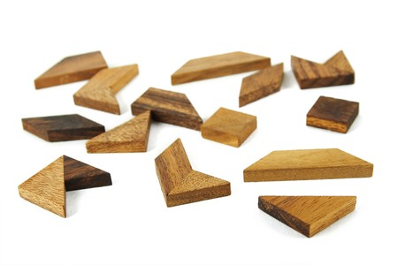 many wooden geometrical figures puzzle isolated photo