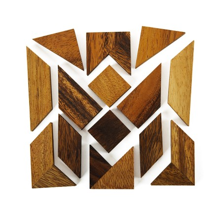 assemble: wooden figures assemble in square puzzle isolated