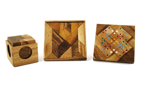 three wooden puzzles isolated photo