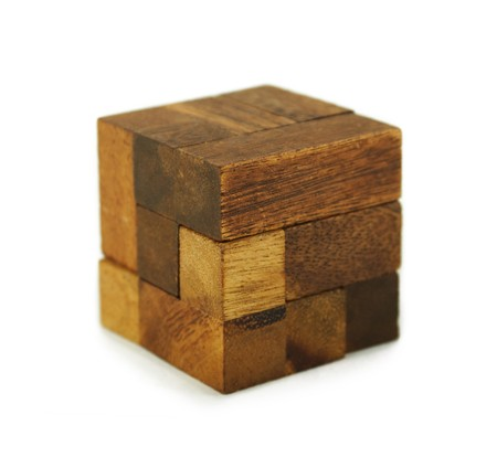 wooden cube puzzle isolated photo
