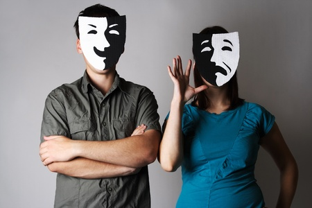 dissimulation: man and woman in theater black and white emotions masks, half body Stock Photo