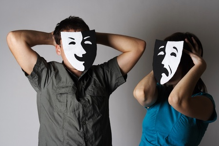 insincerity: man and woman in theater black and white emotions masks, half body Stock Photo