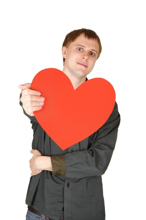 young caucasian man offer red paper heart, decloration of love, isolated photo