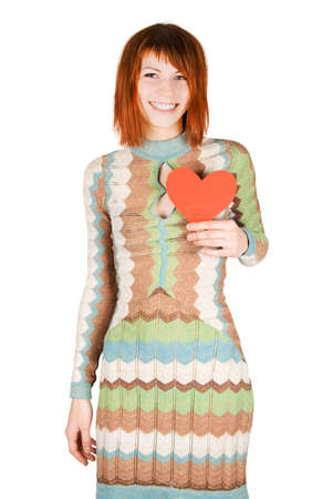 beauty redhead woman in fashion dress standing holding red paper heart iand smiling, isolated Stock Photo - 8678747