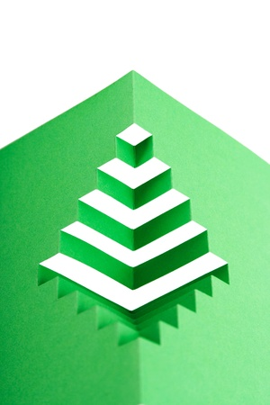 abstract green paper composition with cutout stripes and folds, rhombus shape photo