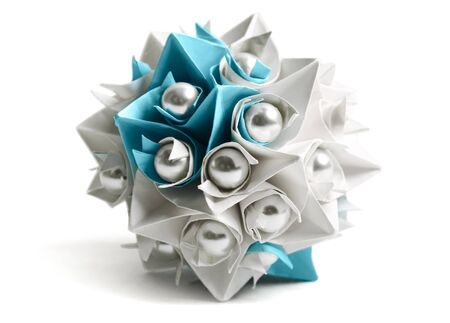 white and blue paper origami ball with pearl, decor element, isolated photo