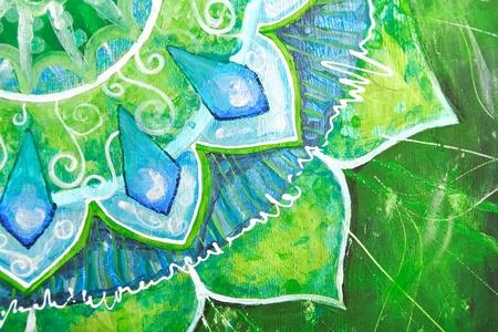 closeup of bright green painted picture with circle pattern, mandala of anahata chakra photo