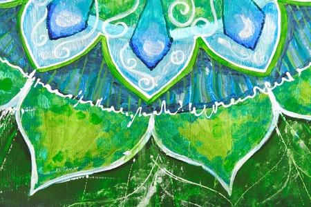 anahata: closeup of bright green painted picture with circle pattern, mandala of anahata chakra