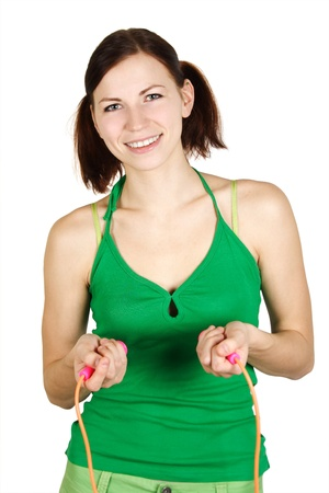 young girl in green shirt with skipping rope, smiling and looking at camera, isolated Stock Photo - 9072298