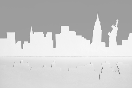 abstract cutout paper silhouette of New-York city, USA, Empire State Building and Statue of Liberty, front view photo