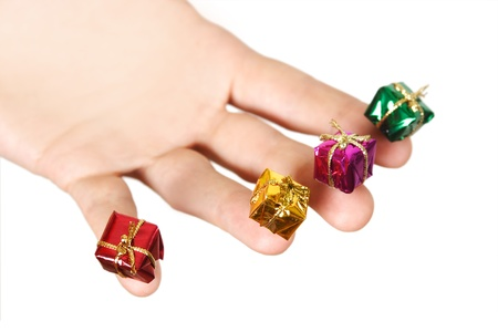 closeup of human hand holding little gifts, isolated photo