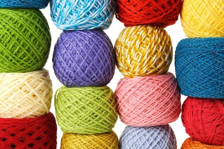 woolen: closeup of many multicolored clews, isolated