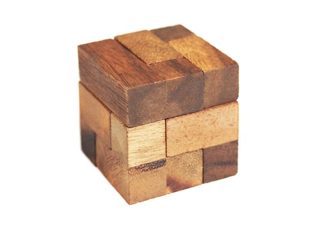 conundrum: wooden cube puzzle isolated