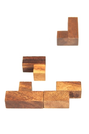 wooden tetris puzzle isolated photo