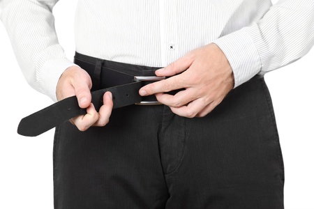 buckle: closeup of man in classic style dress wear belt isolated