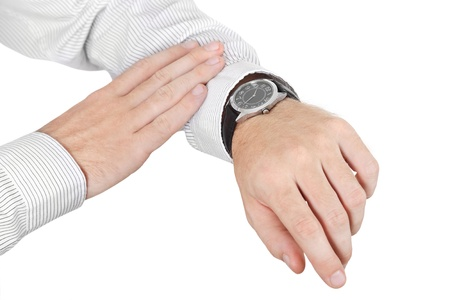 dress code: closeup of man hands with watch isolated