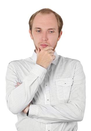 dress code: man in white shirt thinking, hand on chin, isolated