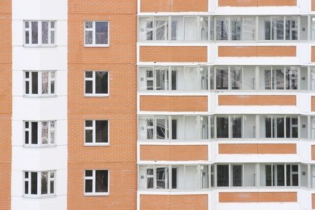 housewarming: facade of red and white new dwelling building