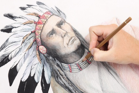 man hand drawing pencil picture with american indian chieftain photo