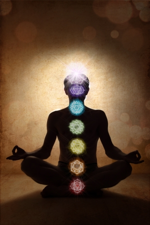 aura energy: Yoga man in lotus pose with chakra symbols