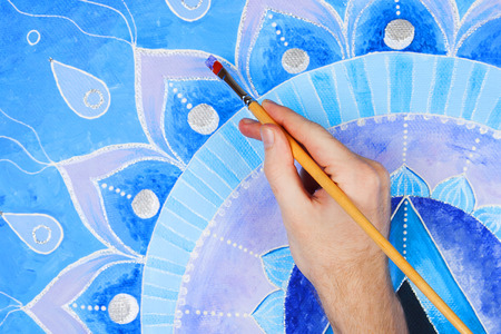 chakra symbols: abstract blue painted picture mandala of Vishuddha chakra