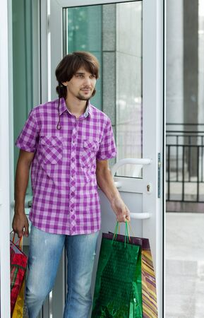 Beautiful young man after shopping  Outdoor shot Stock Photo - 13405244