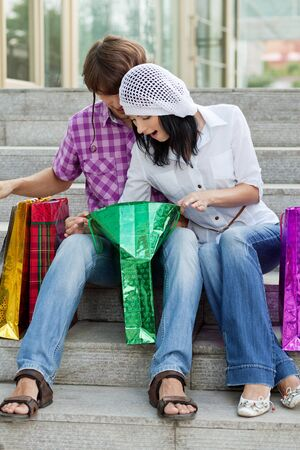 Beautiful young couple after shopping  Outdoor shot Stock Photo - 13405203
