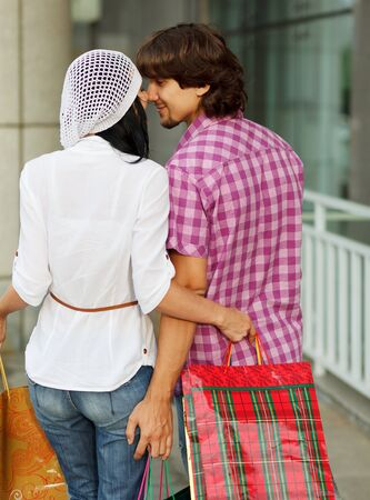 Beautiful young couple after shopping  Outdoor shot photo