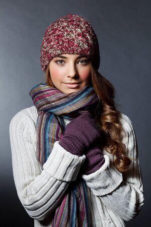winter woman: Beautiful girl in winter clothes  Studio shot Stock Photo