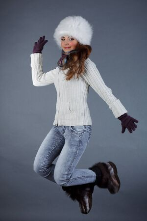 Beautiful girl in winter clothes  Studio shot photo