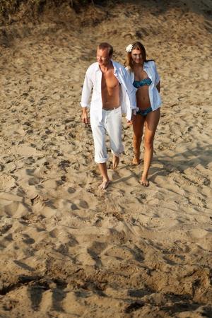 Beautiful couple having rest on river beach Stock Photo - 13405433