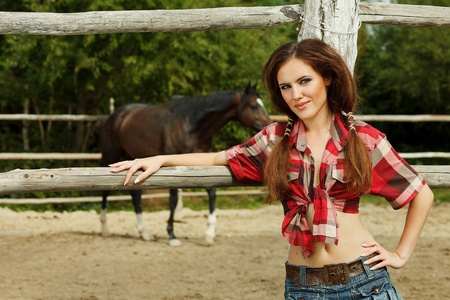 Beautiful cowgirl  Shot in the stable photo
