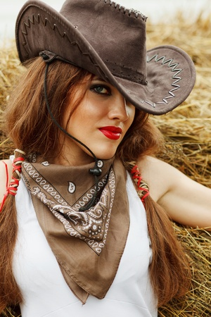 cowgirl and cowboy: Beautiful cowgirl  Shot in the stable