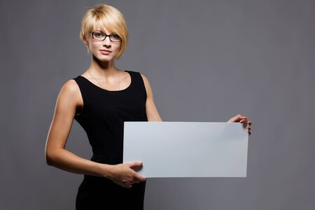 young businesswoman with blank board  Copyspace photo
