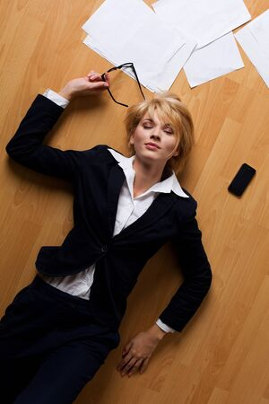 young businesswoman lying on floor photo