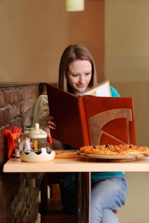 Beautiful college student in pizzeria photo