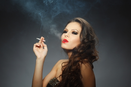 young brunette woman with cigarette photo