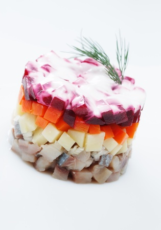 Russian traditional New Year s food  Herring under a fur coat photo