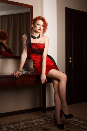 Attractive woman in red photo