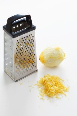 the grater: Zested lemons on white Stock Photo